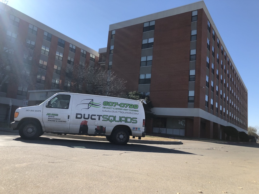 duct squads van at commercial building