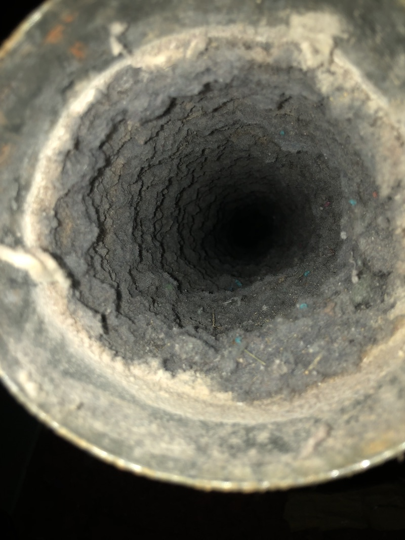 lint-filled dryer vent before cleaning
